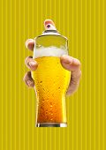 Street Art. Male Hand Holding A Glass Of Cold Beer As A Spray Cannister Against Yellow-braun Backgro poster
