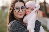 Portrait Of Mother And Her Little Baby Girl. Beautiful Mom And Cute Baby. Mother Hud Her Daughter. B poster