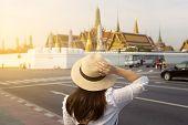 Tourist Is Enjoy Watching The View Of Bangkok Wat Phra Keaw And Grand Palace Landmark Of Bangkok. poster