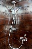 stock photo of shower-cubicle  - chrome shower in a cubicle in bathroom - JPG