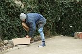 Poor Homeless Man With Cardboard On Street poster