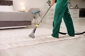 Professional Janitor Cleaning Carpet In House, Closeup poster