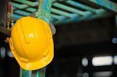 Yellow Helmet Hung On Construction Site,work Safety At Construction Site Concept . poster