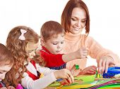foto of arts crafts  - Kindergarden teacher with group children - JPG