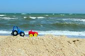 Trip, Childhood,vacation Concept.trip To The Ocean. Little Cars On The Beach.kids Toys On Tropical S poster