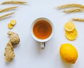 Lemons And Ginger On A White Background.healthy Food. Ginger Root Tea With Lemon. Healthy Ingredient poster