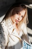 European Young Woman In Vintage Leather Jacket In Fashionable Ripped Jeans In Blue Trendy Cowboy Boo poster