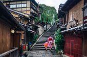 Kyoto, Japan Culture Travel - Asian Traveler Wearing Traditional Japanese Kimono Walking In Higashiy poster