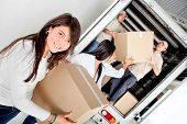 image of post-teen  - Girls moving house and unloading boxes from a truck - JPG