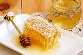 Honey Comb Piece. Honey Slice With Honey Spoon And Jar Of Honey On Wooden Table. Honeycomb Part With poster