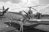 We Love To Fly. Family Couple With Son On Vacation Travel. Woman And Man With Boy Child At Helicopte poster