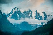 Huge Glacier Reflected In Water Surface. Water Reflection Of Giant Snowy Rocky Mountains Under Cloud poster