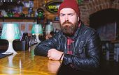 Hipster Relaxing At Bar. Bar Is Relaxing Place To Have Drink And Relax. Man With Beard Spend Leisure poster