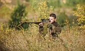 Man Wear Camouflage Clothes Nature Background. Hunting Permit. Hunter Hold Rifle. Hunting Is Brutal  poster
