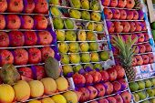 Ripe Oriental Fruits Are On The Counter Of The Oriental Bazaar. Pomegranates, Melons, Mango, Papaya, poster