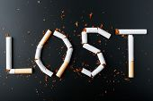 The Inscription Lost From Cigarettes On A Black Background. Stop Smoking. The Concept Of Smoking Kil poster