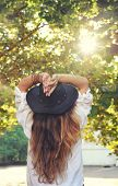 Young boho style woman enjoy sunlight in summer park, hippie, indie style, chic leather black hat, l poster