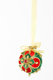 foto of christmas ornament  - a decorative christmas ball tied and hanging with gold organza  ribbon - JPG
