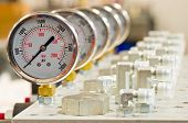stock photo of hydraulics  - Hydraulic Pressure Gauges installed on Hydraulic Equipment - JPG