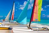 Sailing boats with its colorful sails spread out on Varadero beach in Cuba