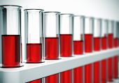 picture of chemical reaction  - Glass laboratory chemical test tubes with red liquid or blood. Selective focus effect