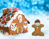 Gingerbread house and man on a festive Christmas snow background.