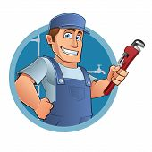 stock photo of overalls  - Plumber sympathetic with a tool in hand - JPG