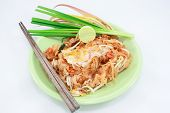 thin rice noodles fried with tofu, vegetable, egg and peanuts (Pad Thai)