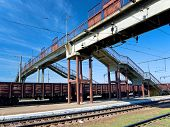 stock photo of freightliner  - Lot of cargo wagons in the train station - JPG
