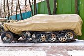 stock photo of military personnel  - Old Russia military armored personnel carrier cover in brown cover - JPG