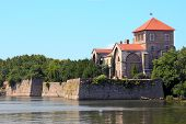 stock photo of tatas  - Castle in Tata Hungary in a sunny summer day - JPG