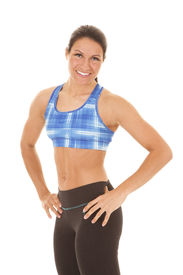 pic of halter-top  - A woman in a blue halter top with hands on her hips - JPG
