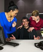 image of immoral  - business women harassing a guy at work - JPG
