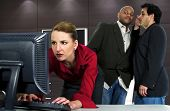 stock photo of indecent  - businessmen harassing a woman at the workplace - JPG