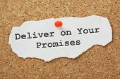 image of honesty  - The phrase Deliver on your Promises typed on a scrap of paper and pinned to a cork notice board - JPG