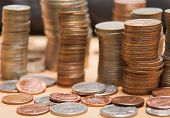 stock photo of penny-farthing  - Coins in stacks - JPG