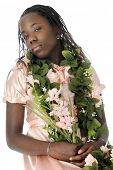 A flower bedecked tween girl appearing snooty as she looks down on the viewer.  On a white backgroun