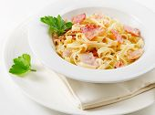 foto of carbonara  - Pasta Carbonara with bacon on a white plate - JPG