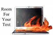 A Genuine Laptop Computer on fire. Isolated on white with room for your text. Represents Computer Da