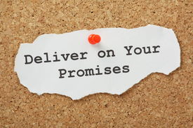foto of promises  - The phrase Deliver on your Promises typed on a scrap of paper and pinned to a cork notice board - JPG