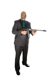 foto of sub-machine-gun  - A Well Dressed Man wears a Gas Mask and brandishes a genuine Thompson Sub - JPG