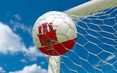 foto of gibraltar  - Gibraltar flag and soccer ball football in goal net - JPG