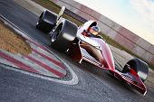 foto of race track  - Race car racing on a track with motion blur - JPG