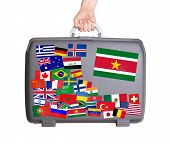 picture of suriname  - Used plastic suitcase with lots of small stickers large sticker of Suriname - JPG
