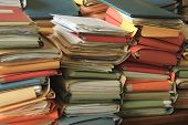picture of piles  - Stacked office files - JPG