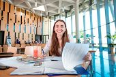 foto of canteen  - Girl studying in the University canteen with Fresh and cake - JPG