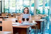 pic of canteen  - Girl studying in the University canteen with Fresh and cake - JPG