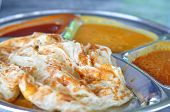 foto of malaysian food  - Roti canai flat bread Indian food made from wheat flour dough - JPG