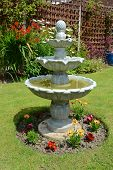 stock photo of fountain grass  - Summer time home garden fountain on a summers days - JPG