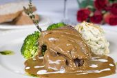 stock photo of camel-cart  - A la carte meal of camel steak in a gravy sauce - JPG